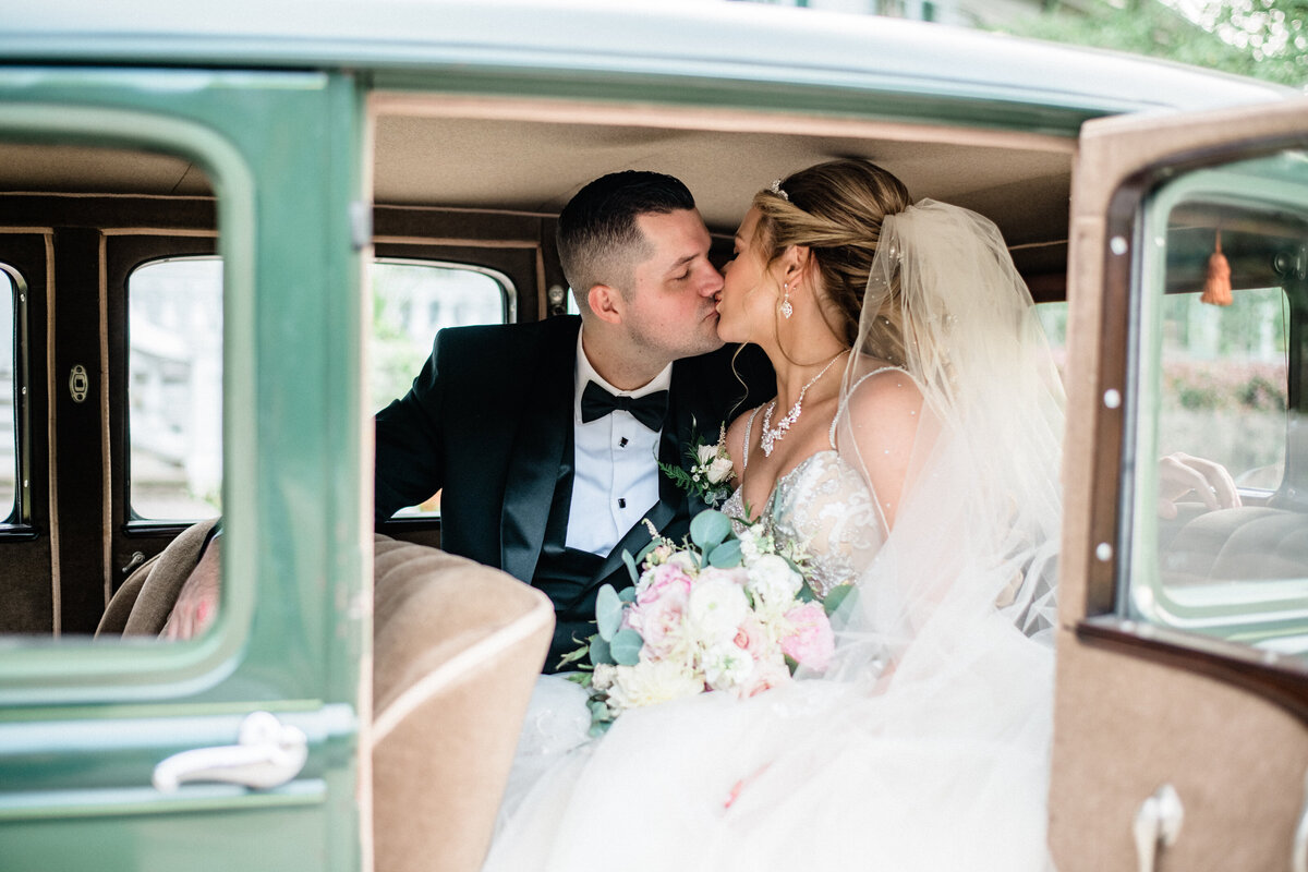 Bride & Groom in an old fashioned car at their wedding designed by Columbus wedding designer