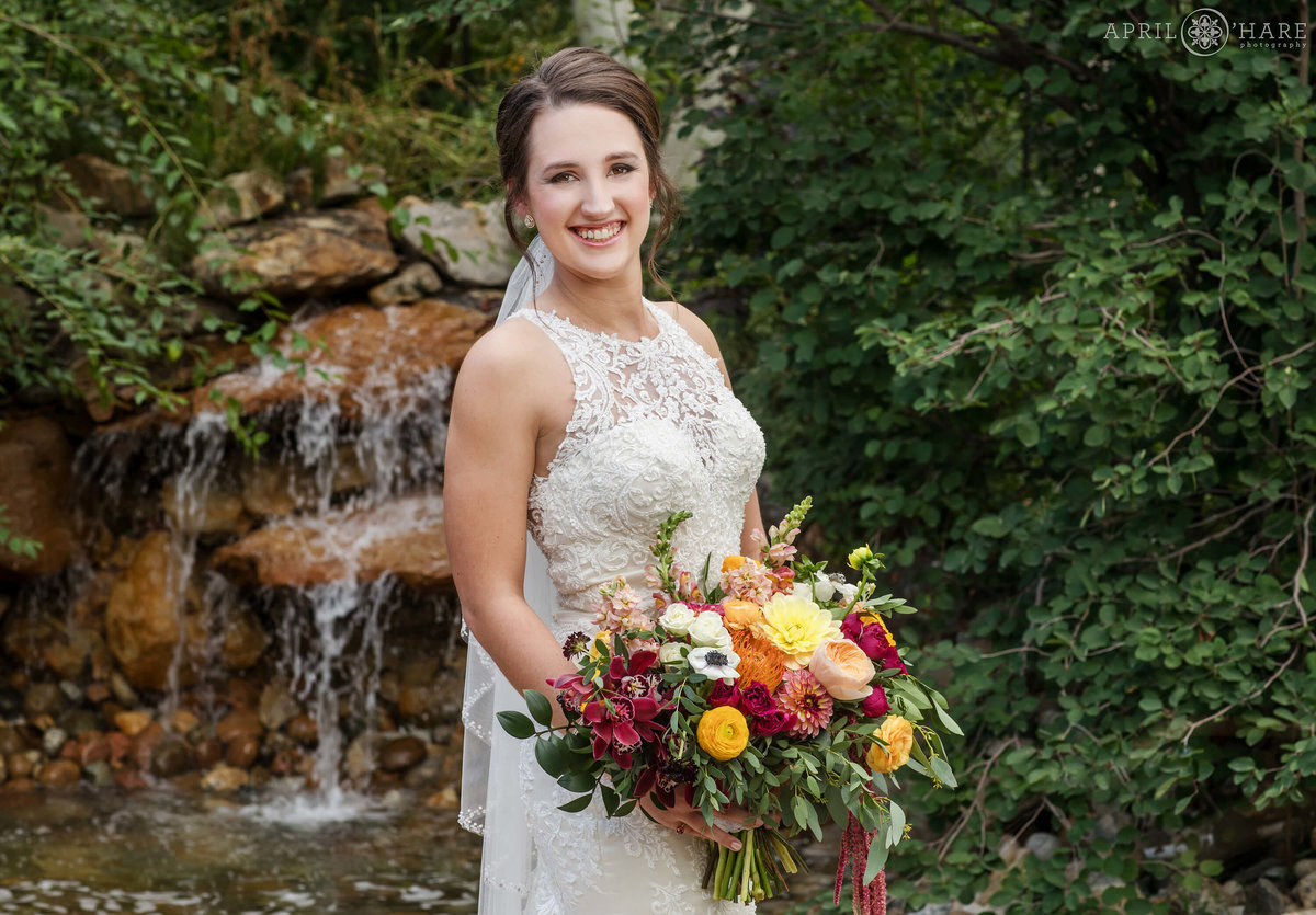 Church Ranch Event Center Waterfall Bridal Portrait During Summer