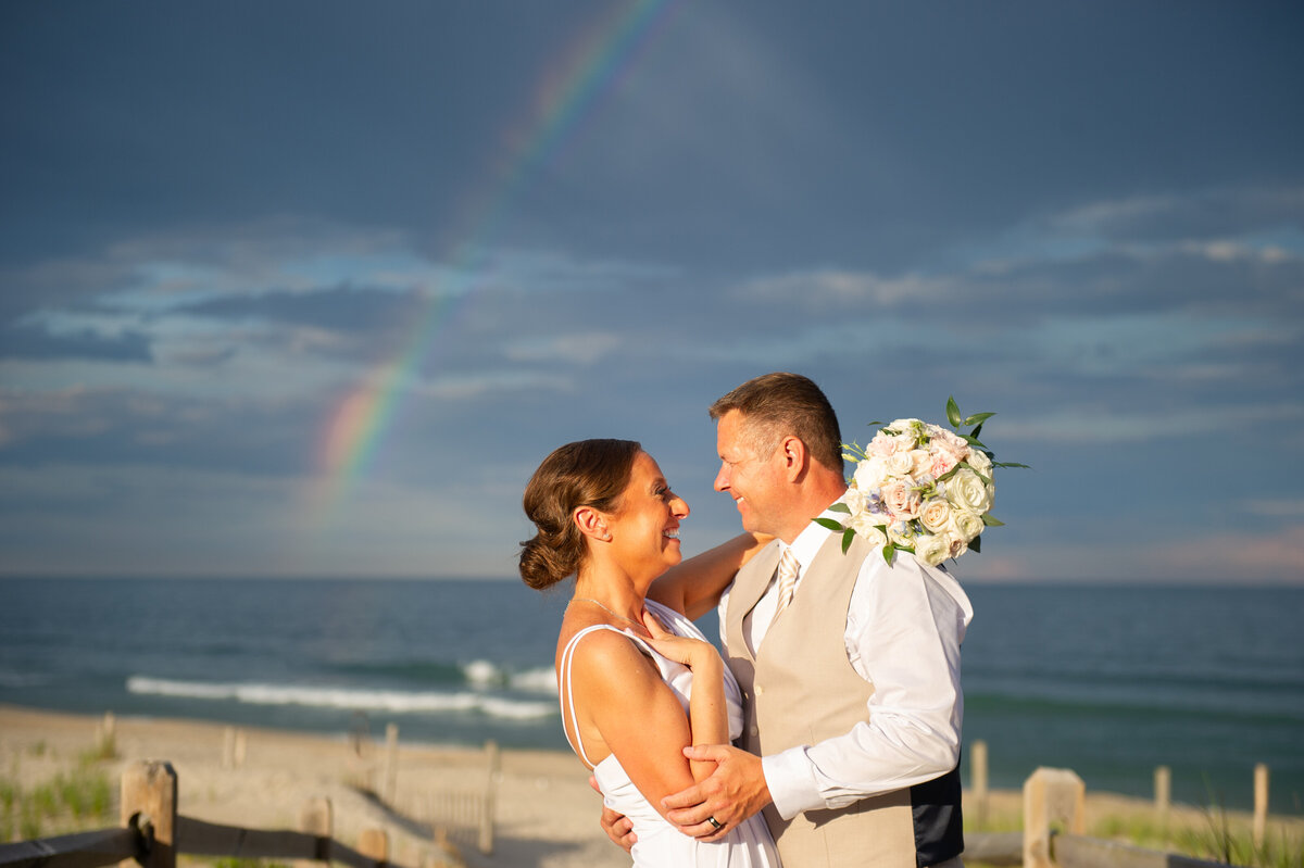 bride and groom under rainbow NJ