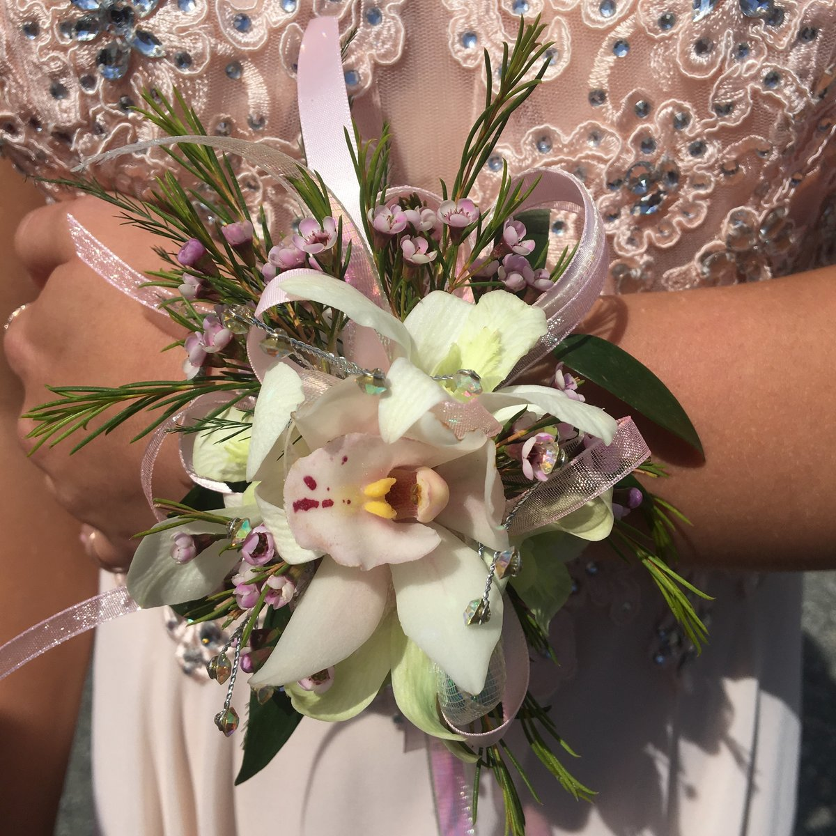 White and pink cymbidum wrist corsage