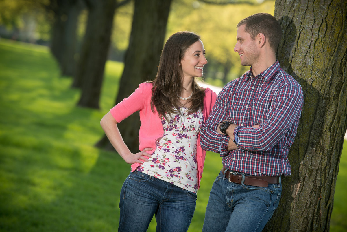 Engagement couple among a row of large trees at cantigny park