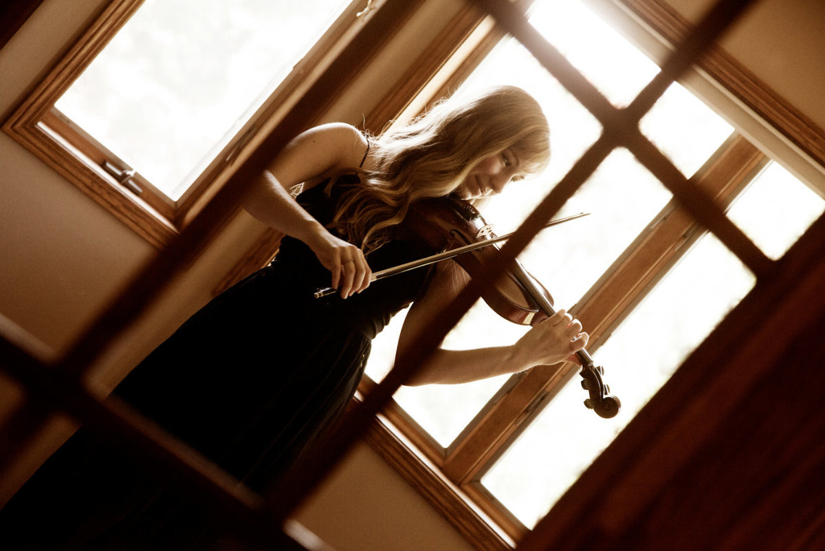 girl plays violin at home through window Dan Elliott Photography