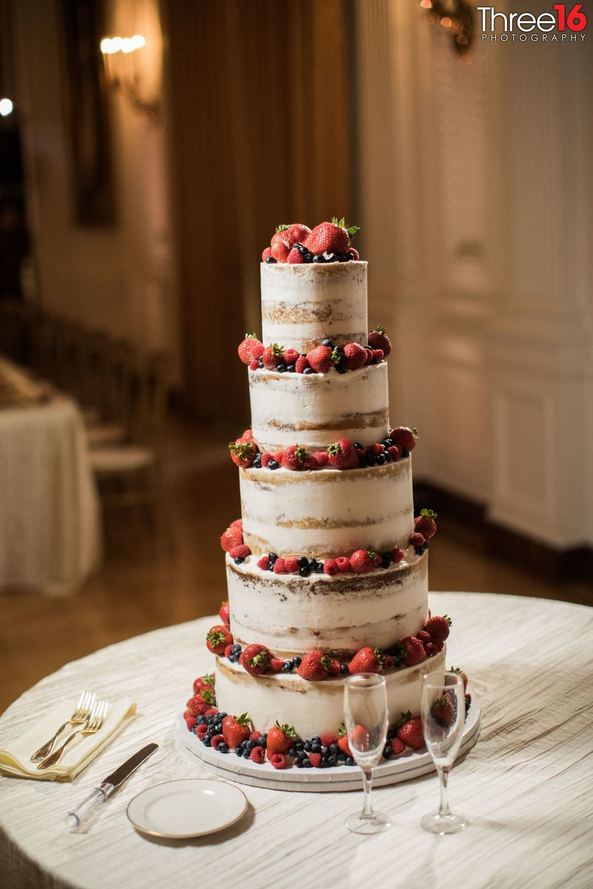 Amazing 5-tiered berry laced naked wedding cake