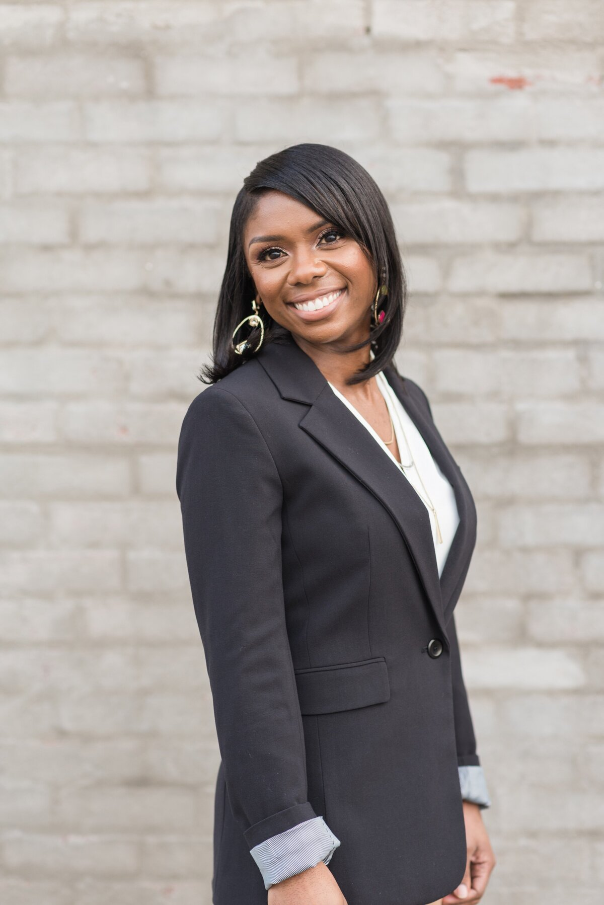 Headshot of a black bsuiness woman wearing a blazer in Nashville, TN