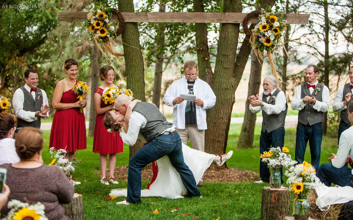 Dramatic Wedding Kiss at outdoor Fall wedding ceremony on a Nebraska Farm