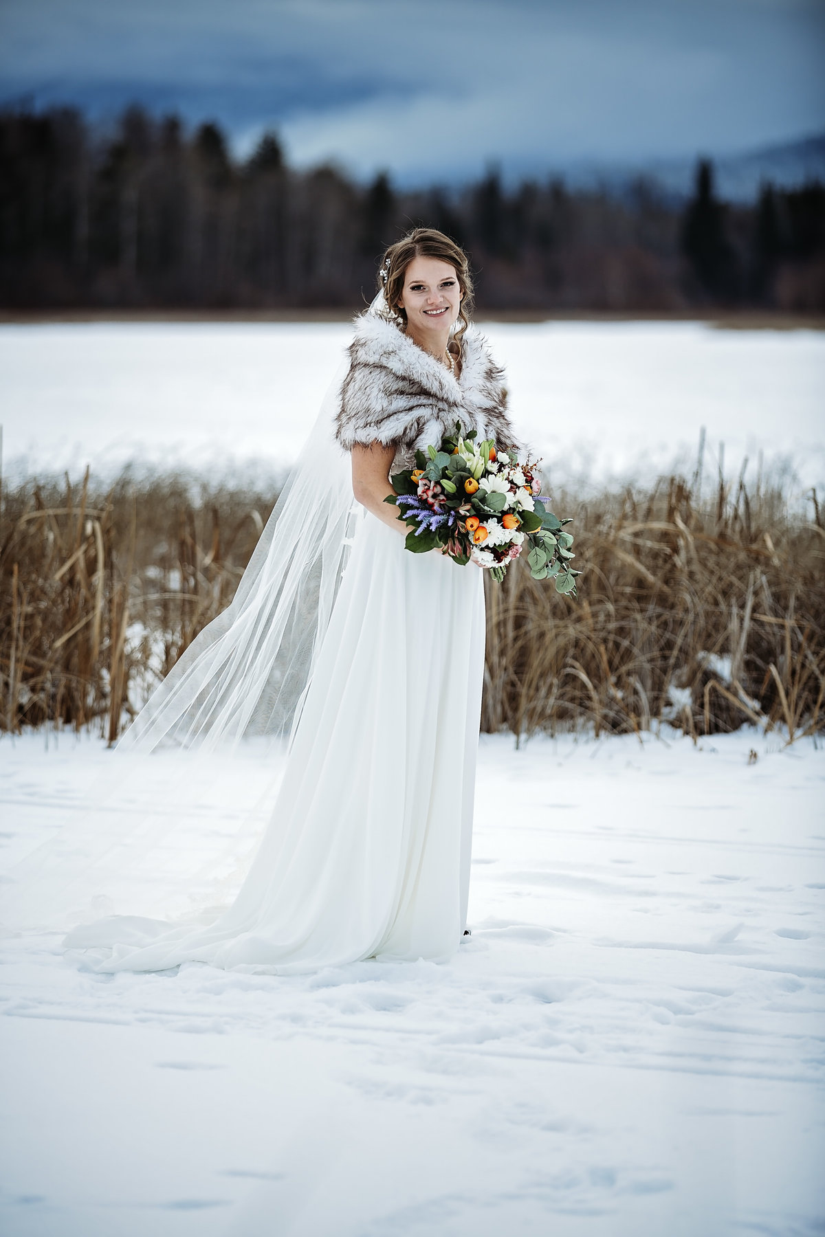 Bride in Winter wedding photography on Marsh in Valemount BC
