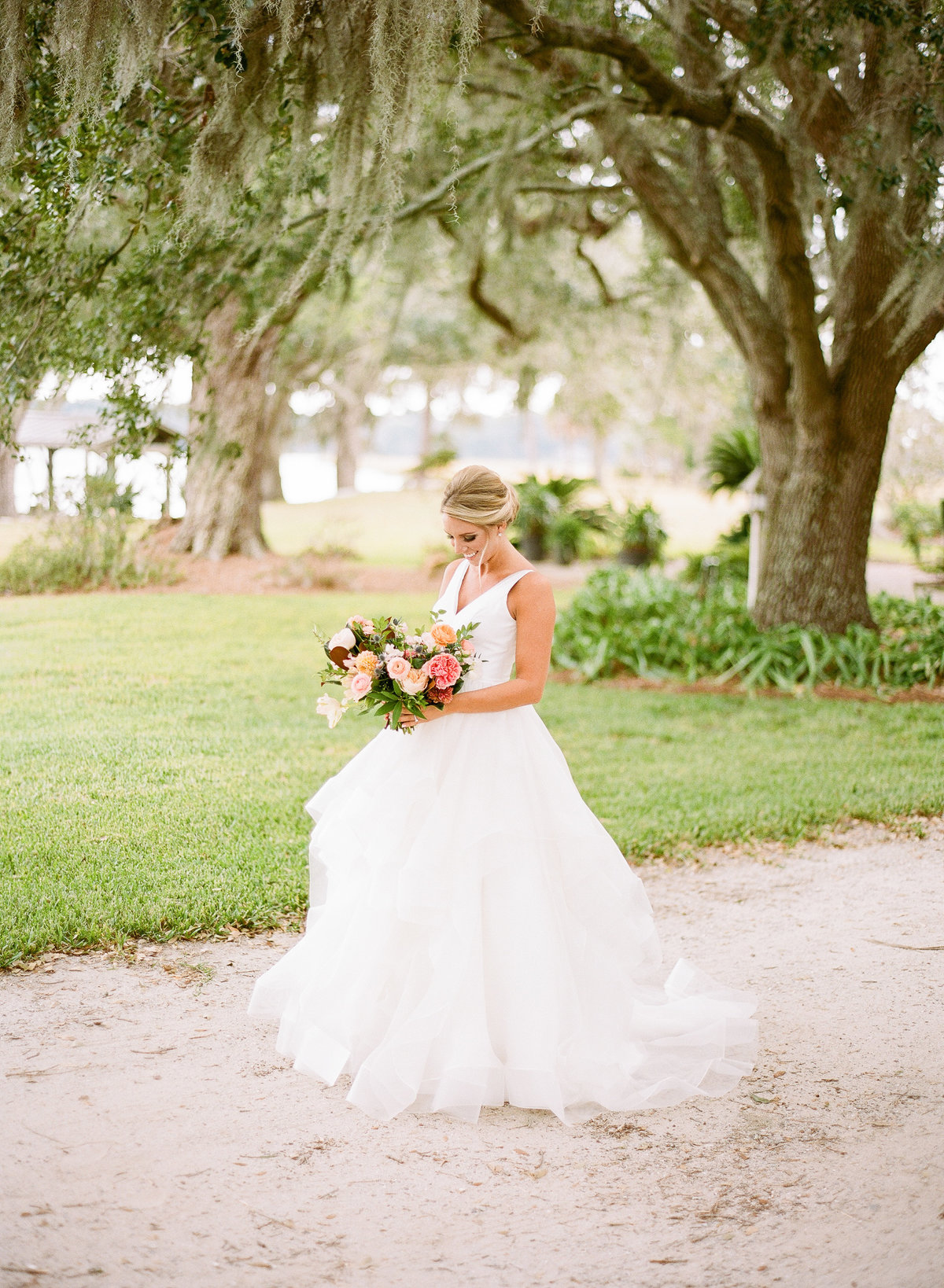 Bride Alexis in Modern Trousseau Ball Gown with Colorful bouquet from Branch Design Studio Charleston Wedding