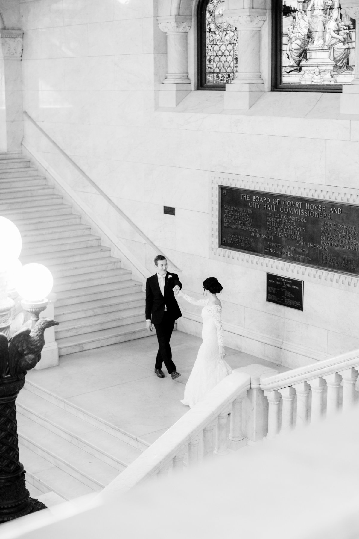 minneapolis city hall wedding grand stairscase in black and white