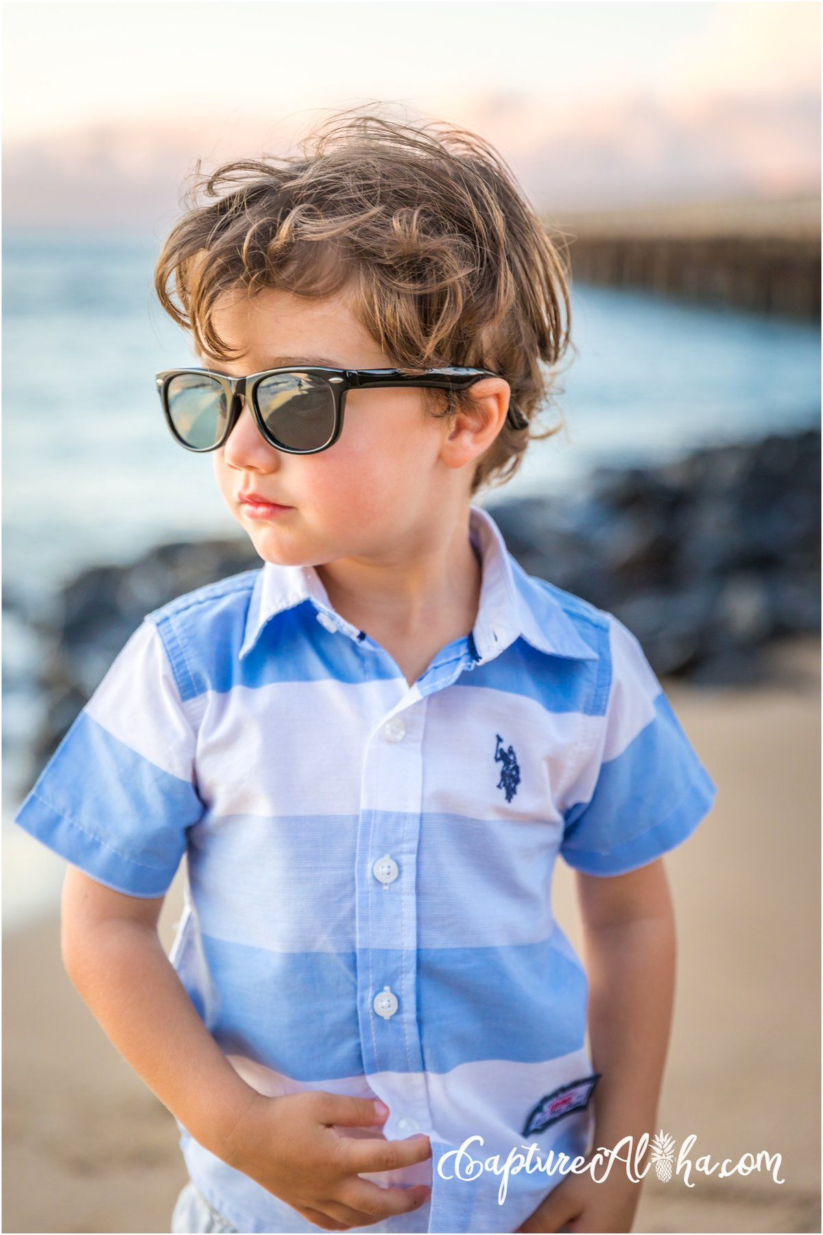 Maui Family Photography at Baby Beach with little boy wearing sunglasses on the beach
