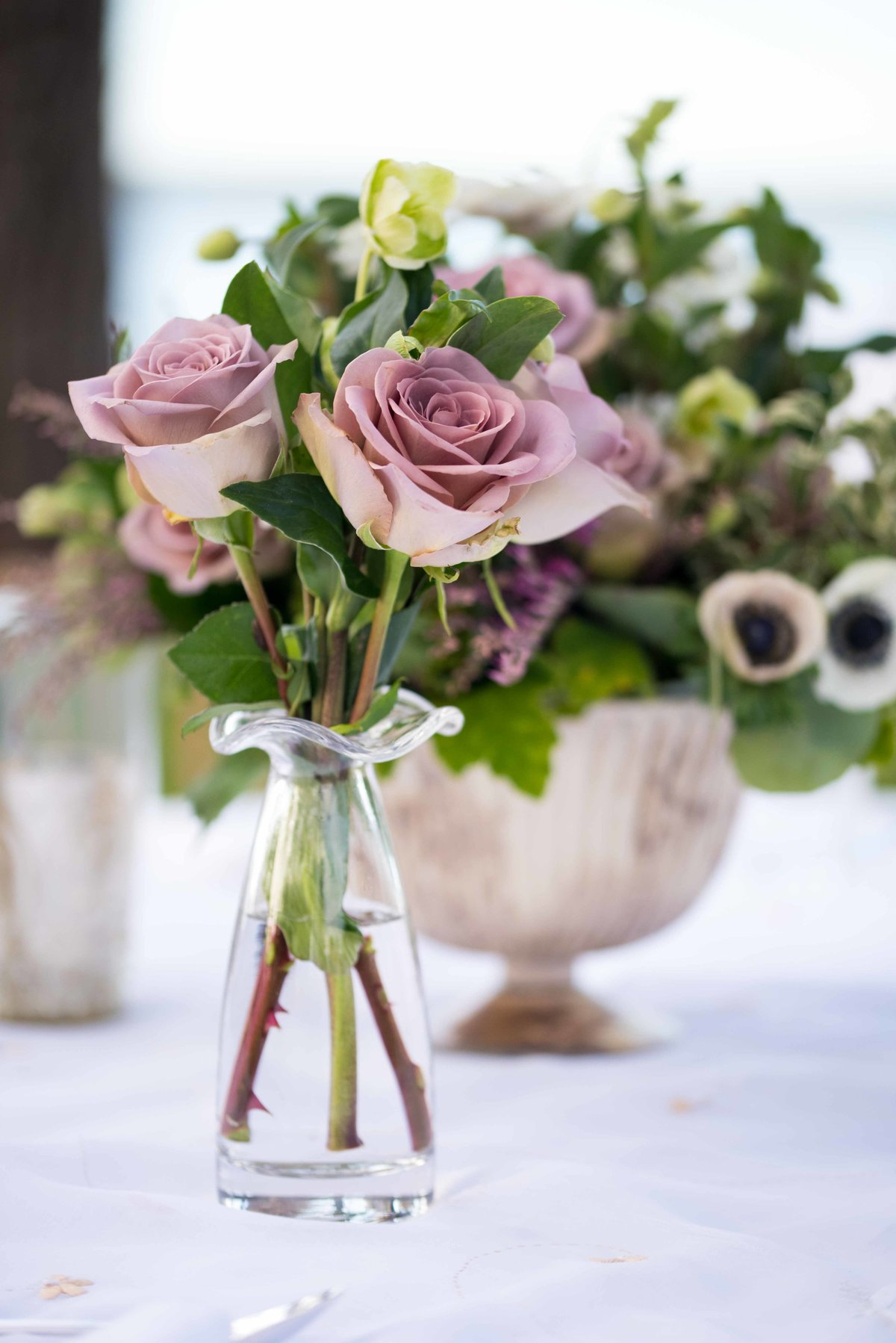 Floral centerpieces with purple roses for a Charleston, SC wedding