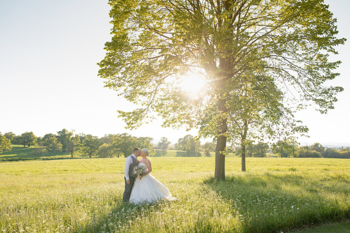 Couple at sunset walking at the front of Rockbeare Manor Exeter