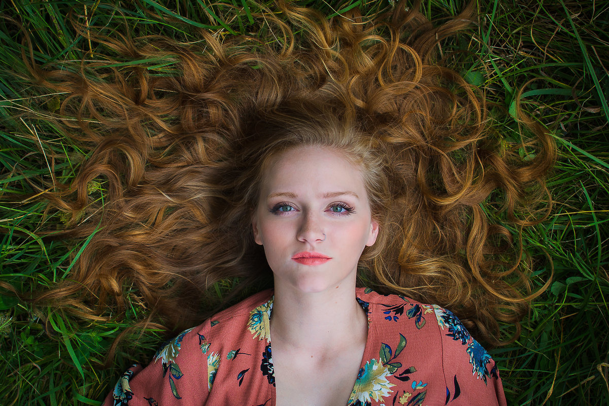 Senior Session Girl Laying in Grass