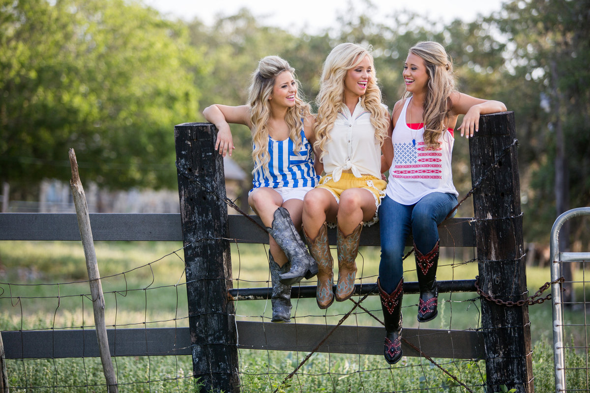 photo of three high school senior girls sitting on fence by San Antonio senior photographer