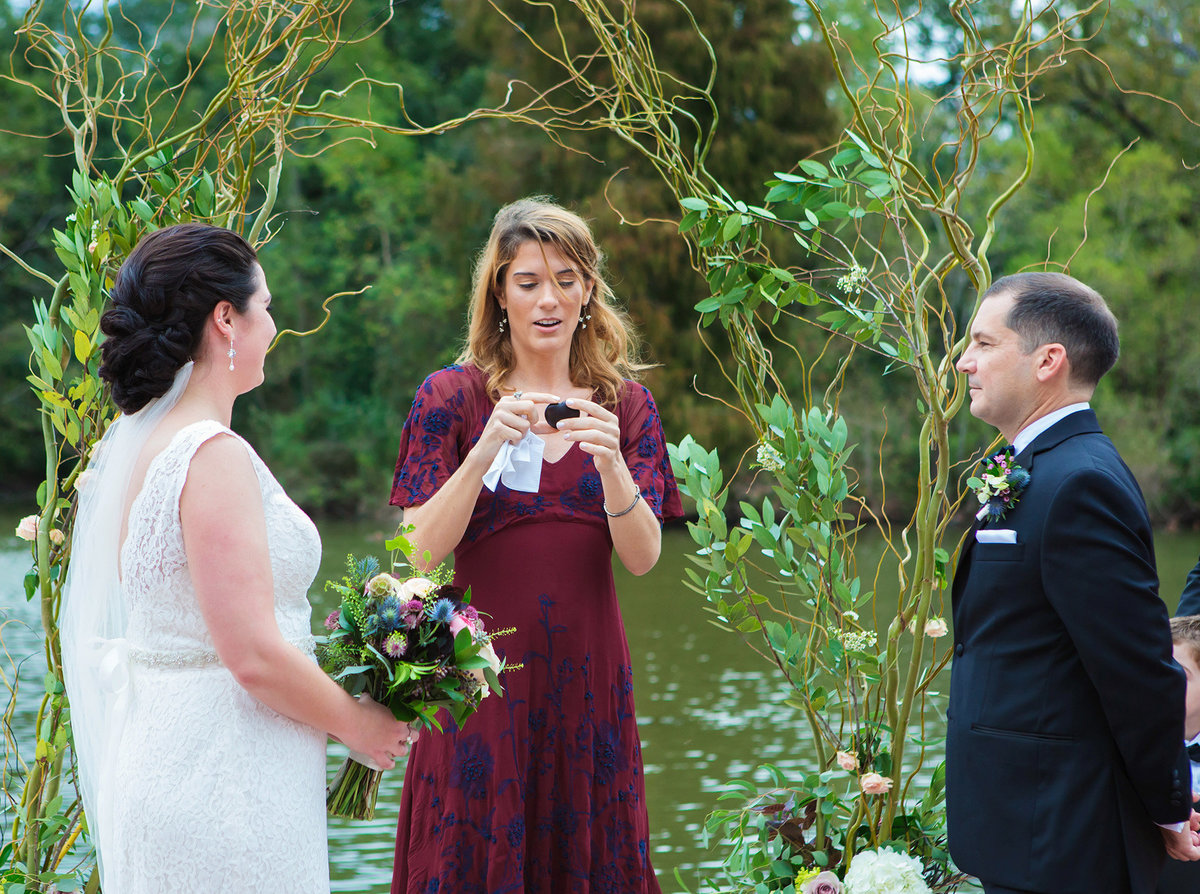 NOLA officiant marrying couple at Newman Bandstand in Audubon Park
