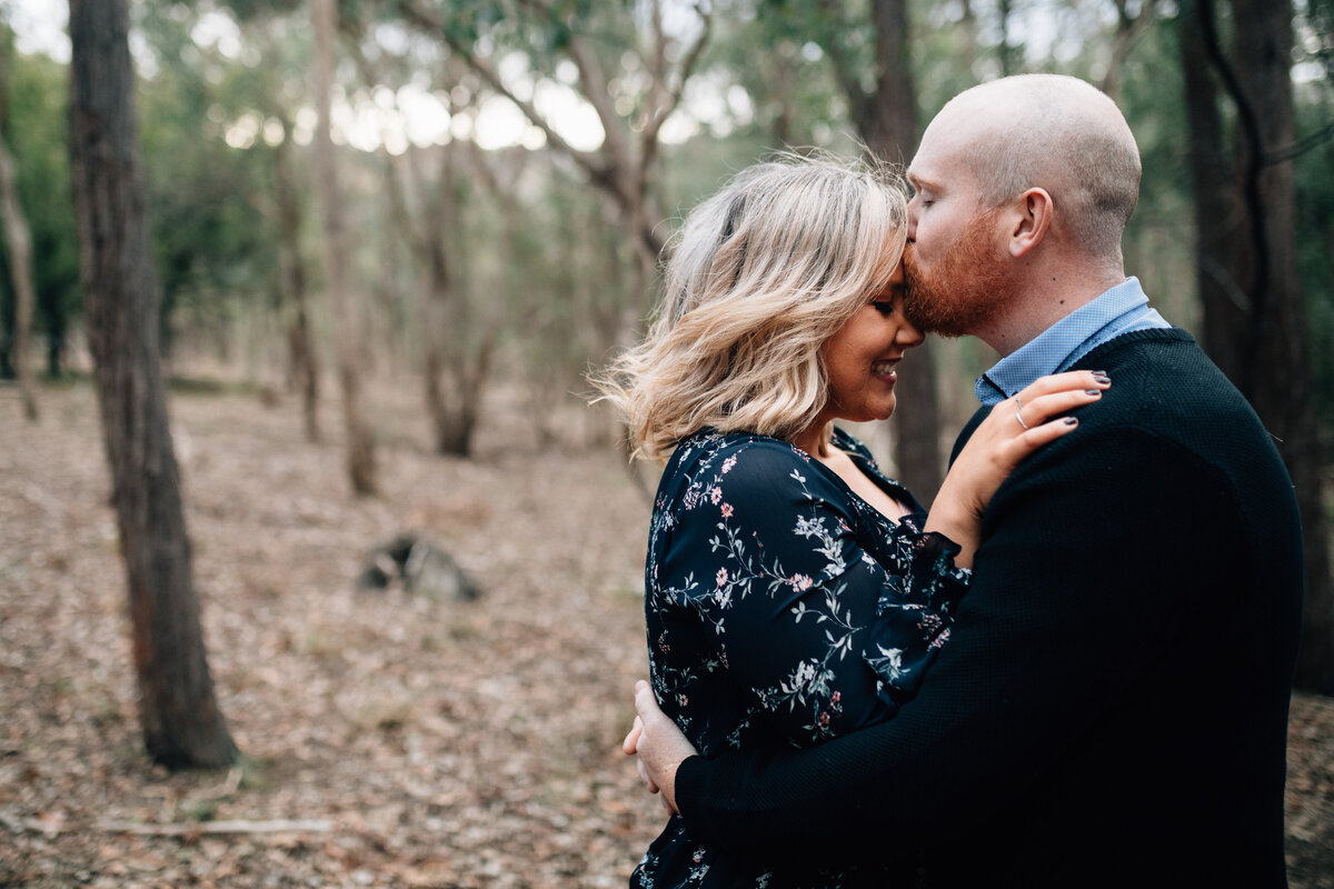 man kissing fiancees forehead engagement and couples photography Melbourne And So I Don't Forget Photography