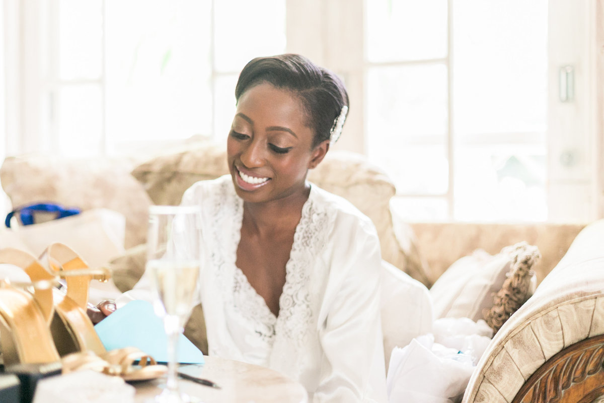 Bride writing personal note for groom on wedding day