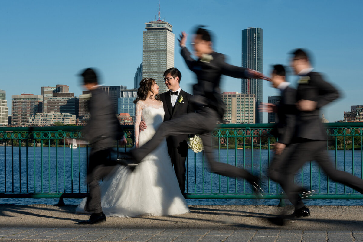 Boston skyline with bride and groom and wedding party