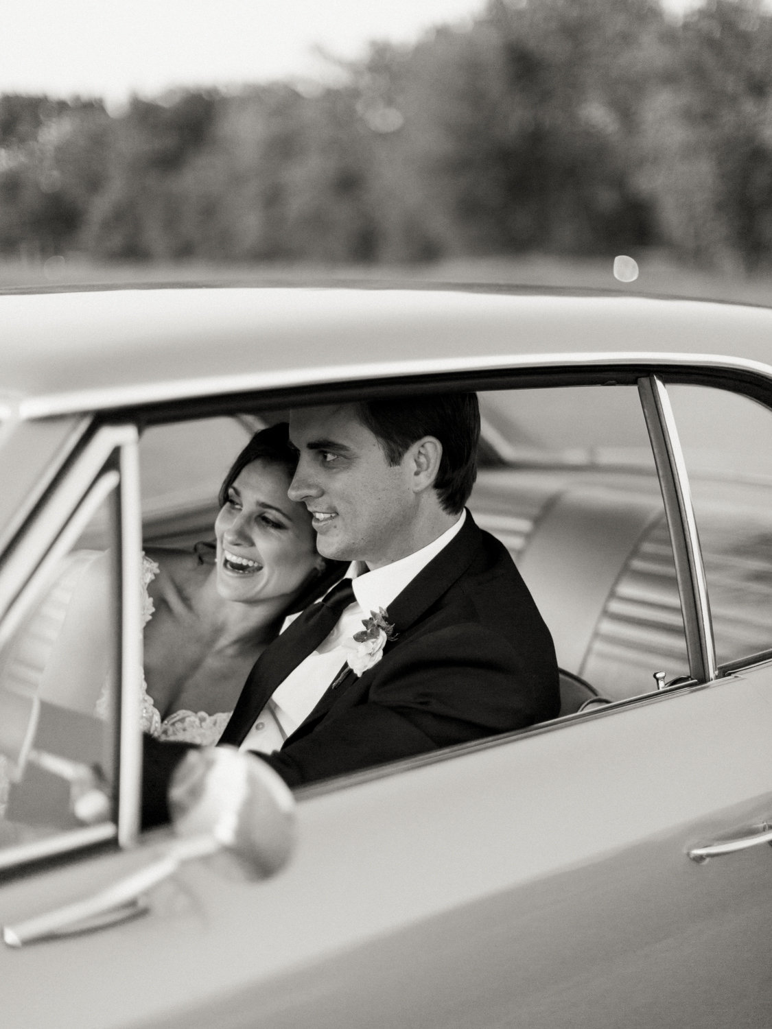 Houston Wedding-bride and groom in getaway car