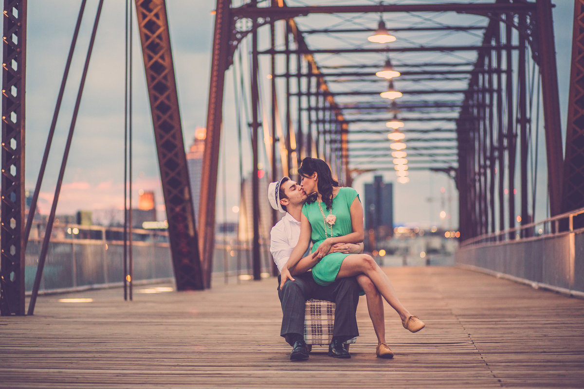 Famous image of engaged couple kissing on Hays Street Bridge in San Antonio. Best engagement session on Hays Street Bridge.