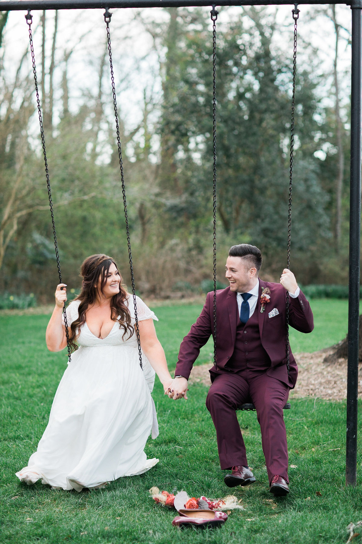 Wedding Photographer, bride and groom sitting together on swings