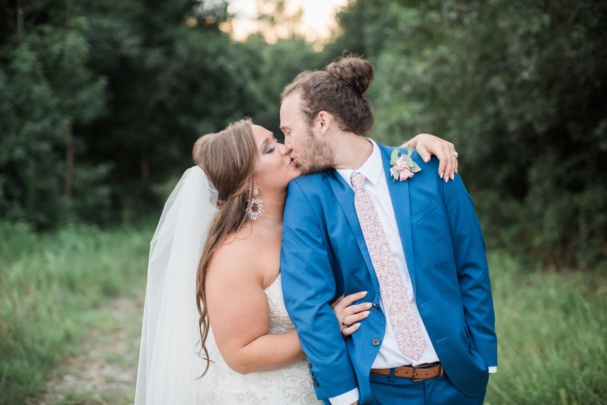 Wedding Photographer, couple kissing on a dirt road