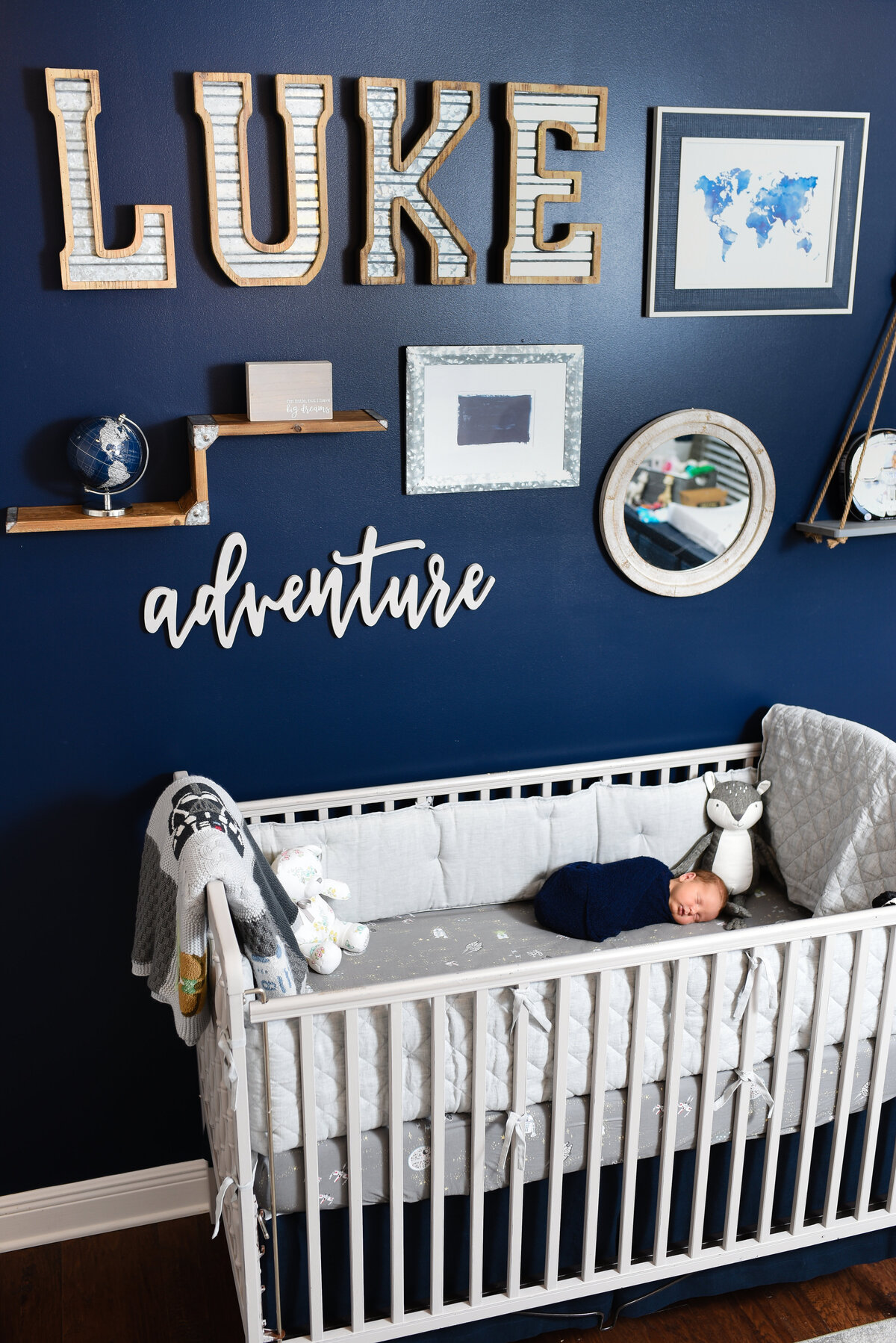 Beautiful lifestyle newborn photography: Newborn boy in his crib in his Star Wars nursery in Pass Christian, Mississippi