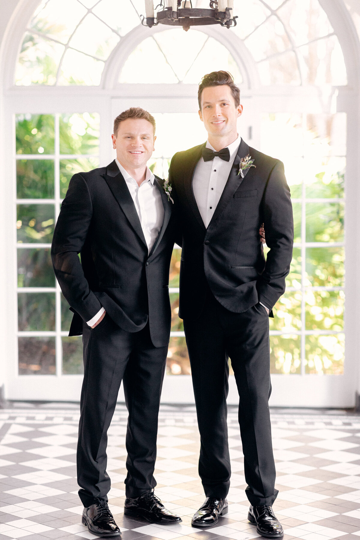 groom and best man in black tuxedos at Lowndes Grove wedding