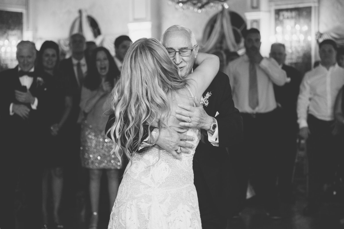 black and white photo of bride dancing with dad at Giorgios Baiting Hollow