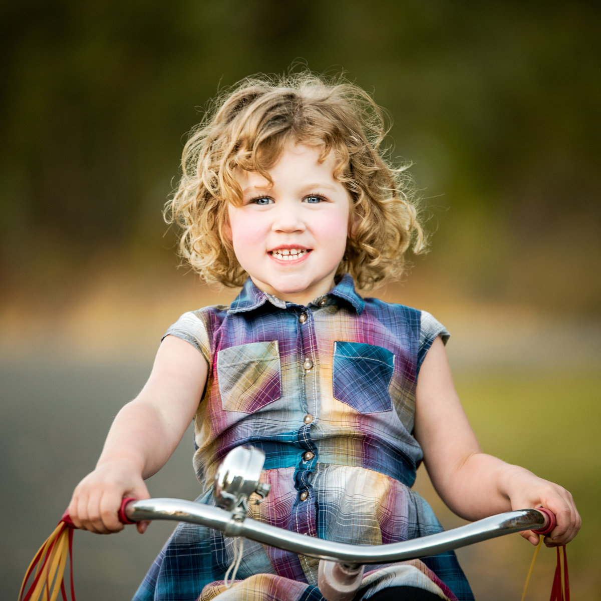 Young girl on a vintage tricycle in Ellensburg Washington