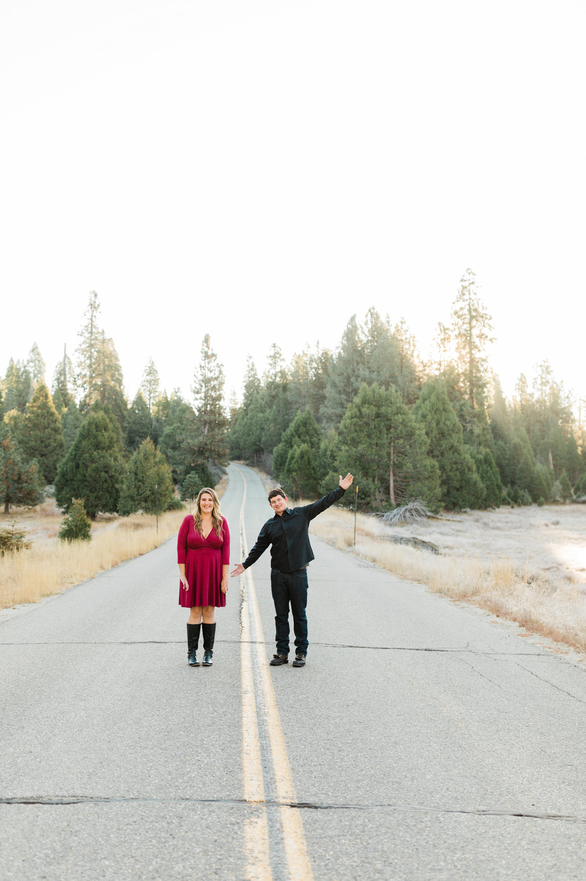 engaged couple having fun with their engagement photos with fresno wedding photographer megan helm