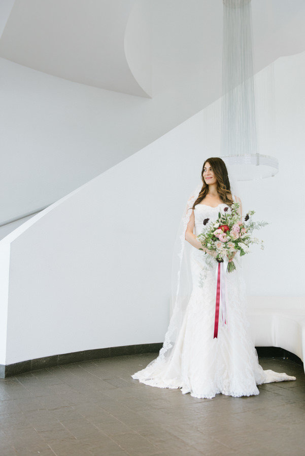 Elegant bride on a rainy day at maritime parc