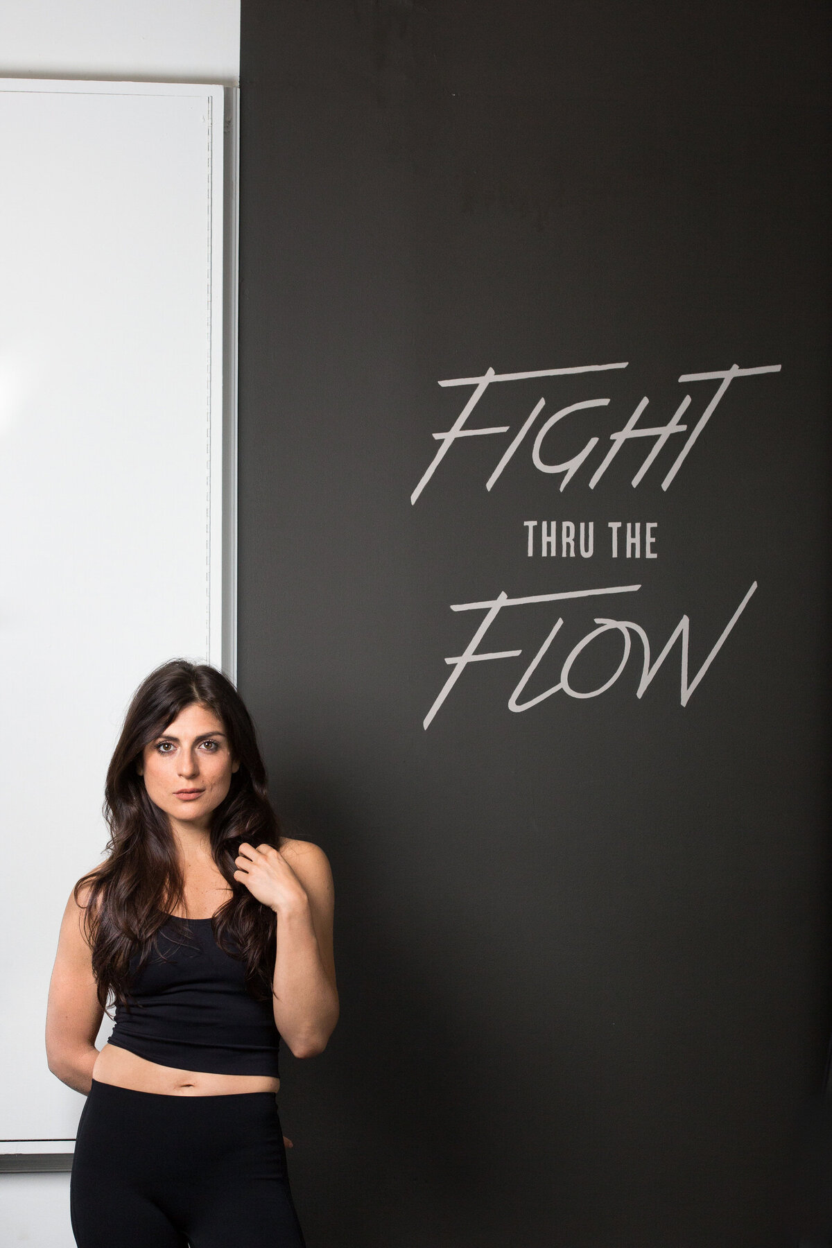 woman standing next to flight thru the flow sign