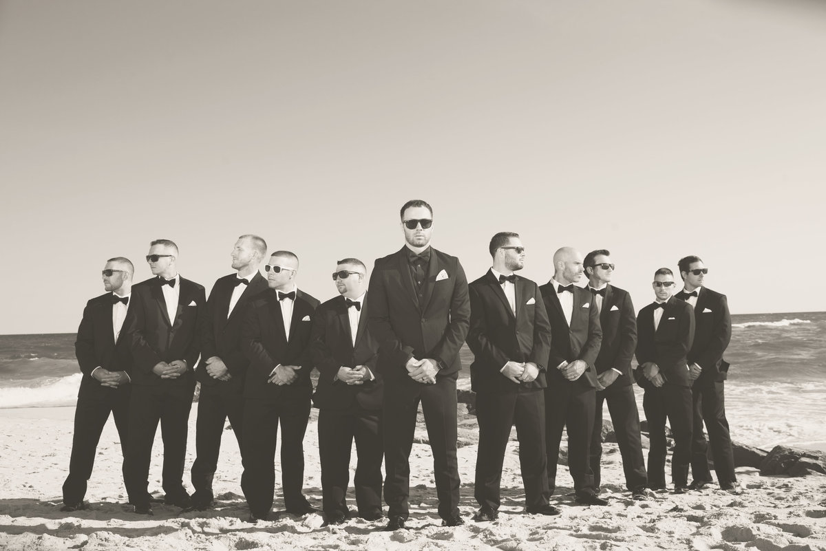 Black and white photo of groomsmen at Oceanbleu beach