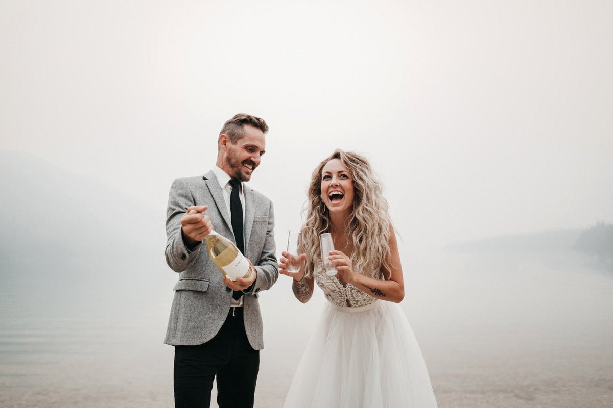 athena-and-camron-sara-truvelle-bridal-wenatchee-elopement-intimate-34-champagne-pop-bride-groom-fun