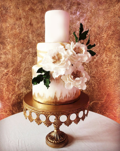 Whippt Desserts Wedding Cake featuring gold brush strokes and handmade sugar blooms