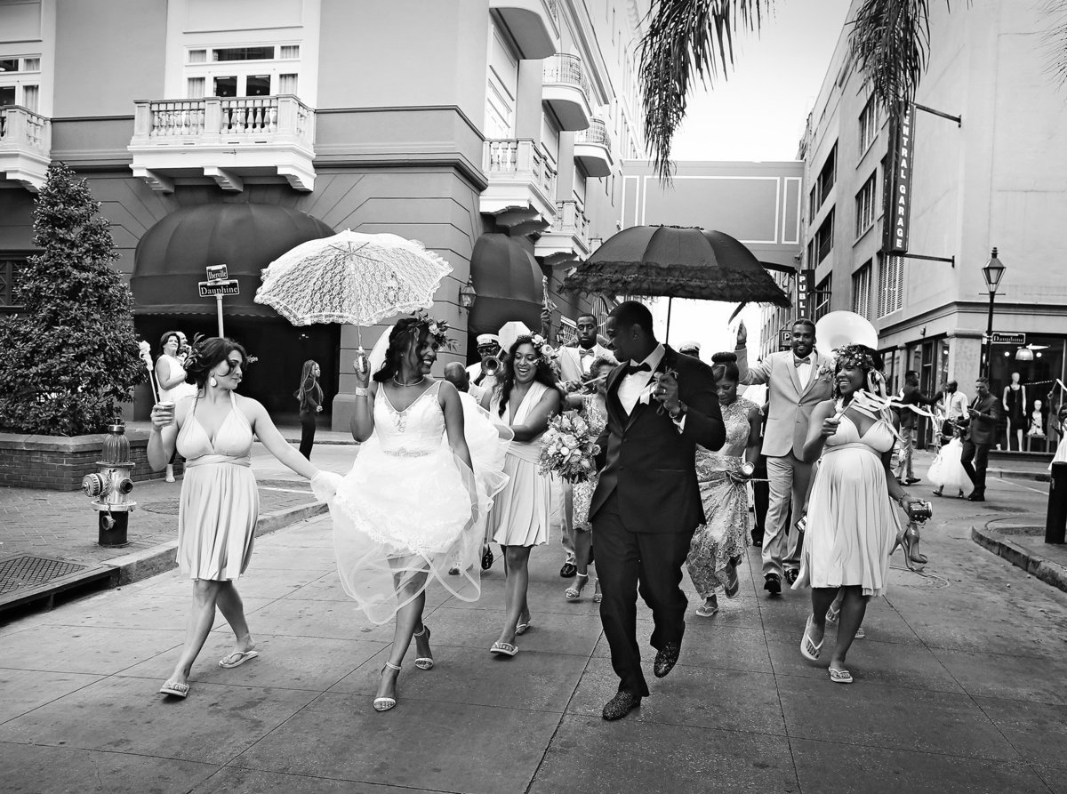 bride and groom dancing in second line parade