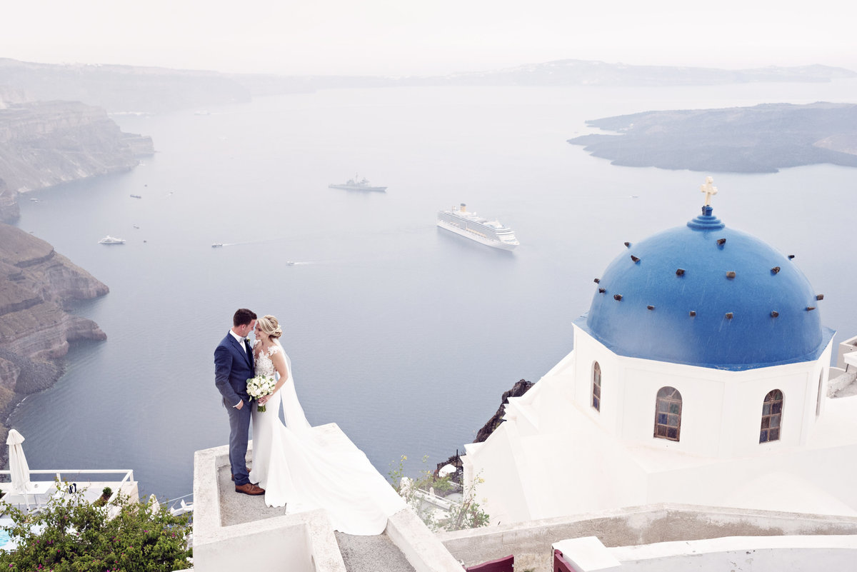Bride and Groom in Santorini at the blue domes