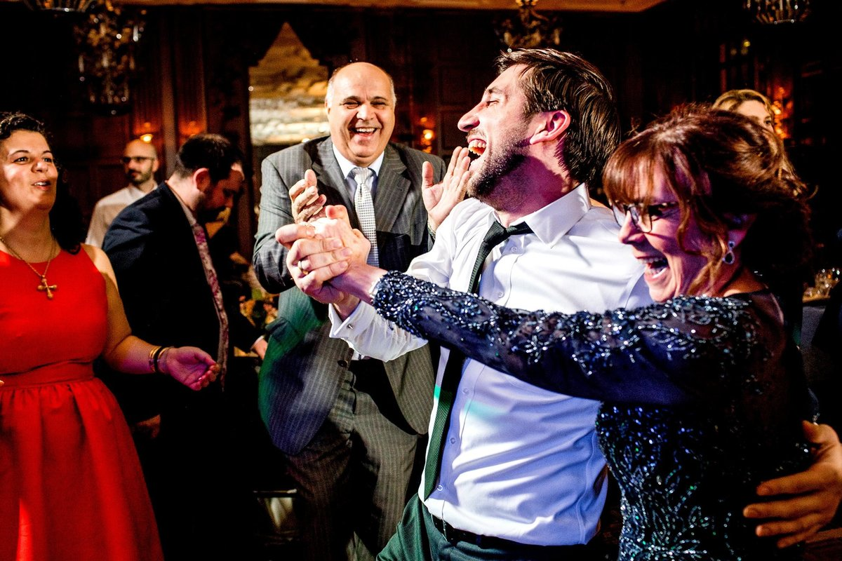 Guests dance together at a Hotel Allegro wedding reception in Chicago.