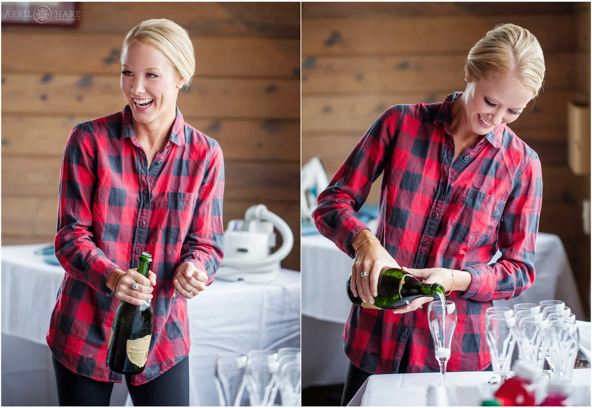 Bride in a cute red plaid shirt pops the champagne prior to getting into her gown in Steamboat Springs Colorado