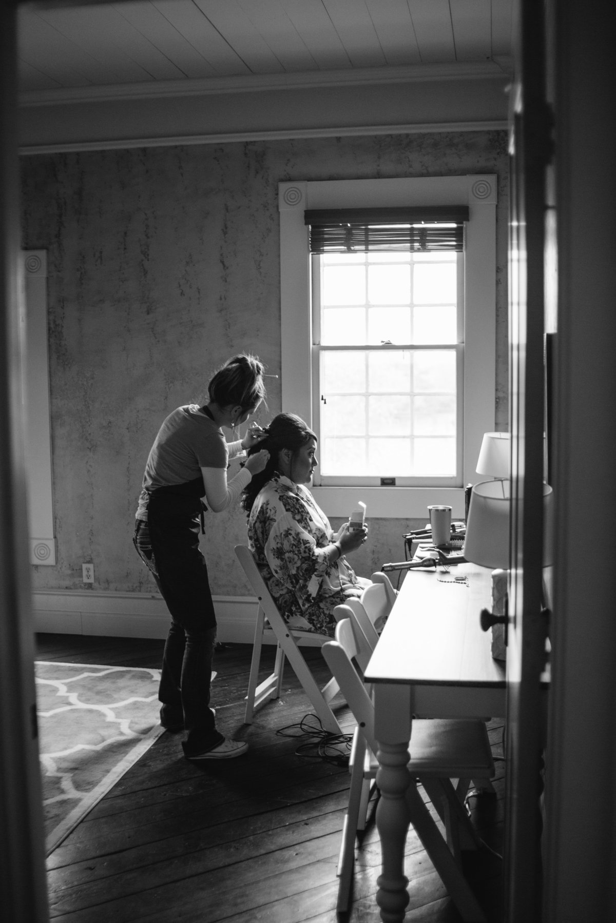 Bride getting hair and make up ready before wedding ceremony at Grande Hall at Hoffman Ranch Texas Hill Country venue