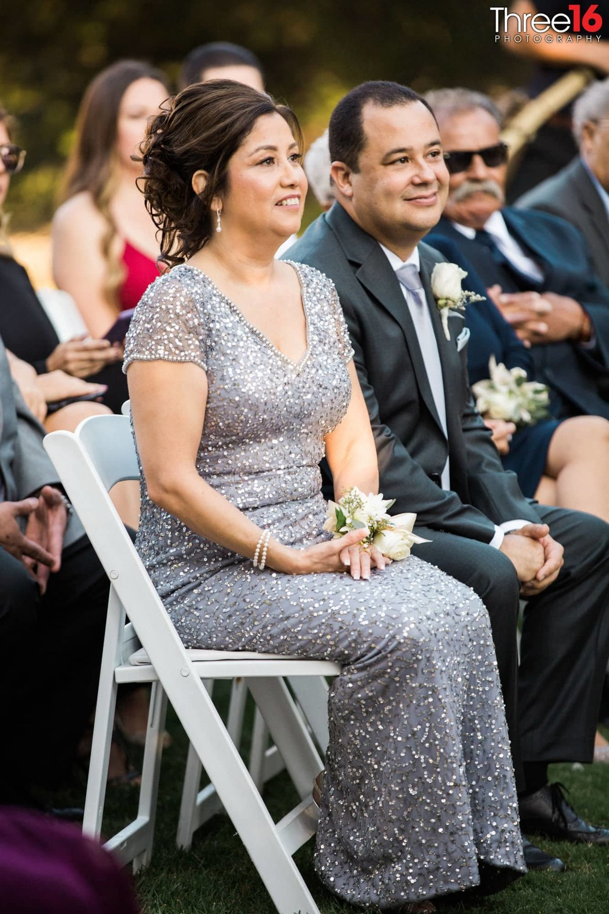 Parents of the Bride watch their daughter get married