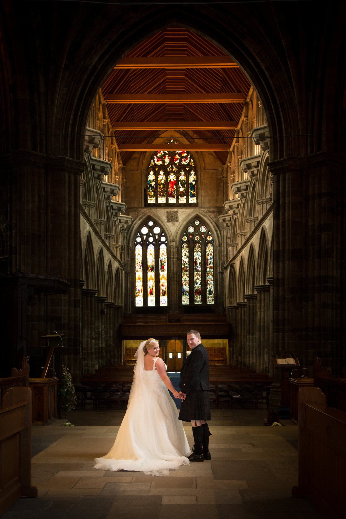 Bride and groom in stunning abbey setting