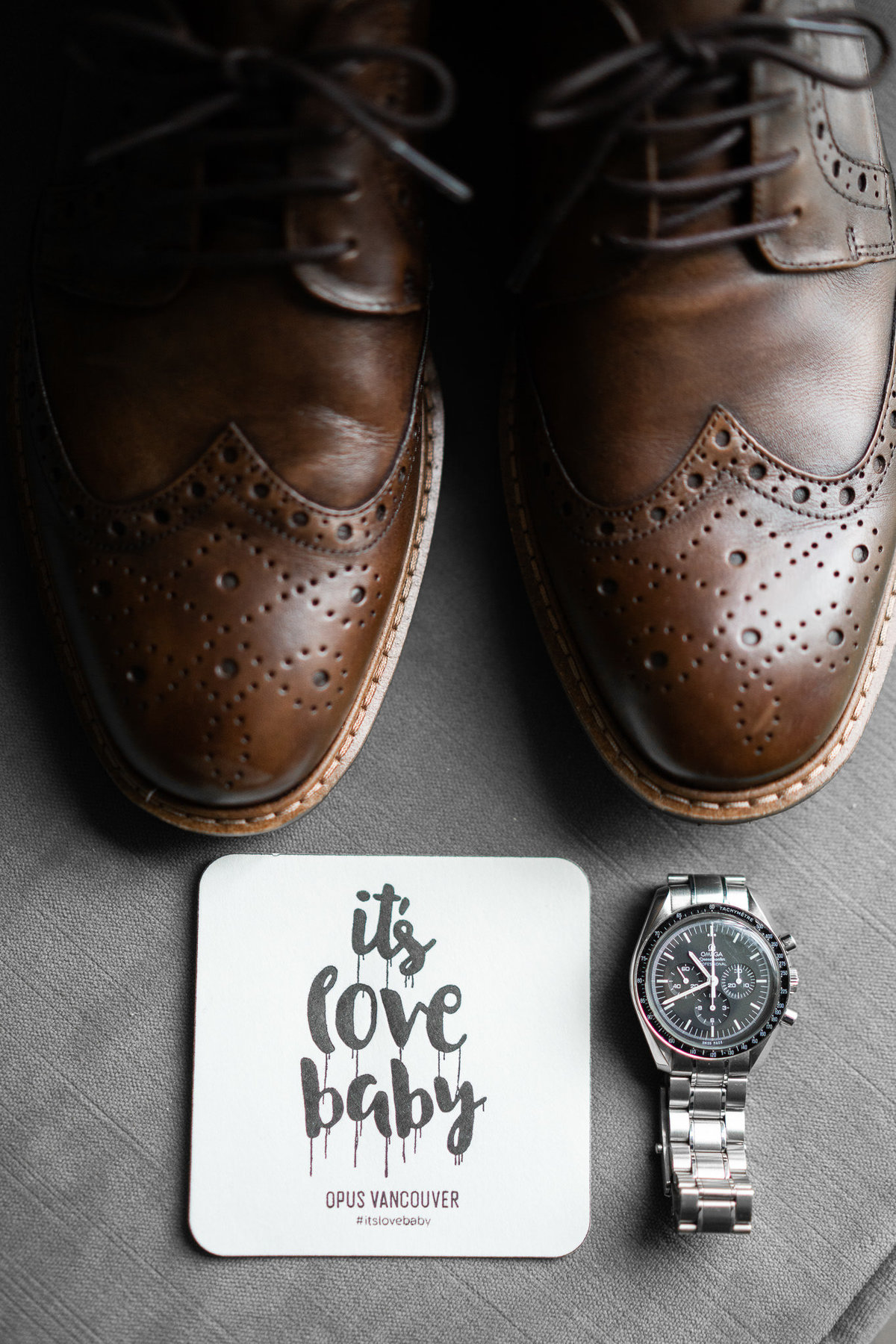 detail photo of grooms watch and shoes at Opus Hotel