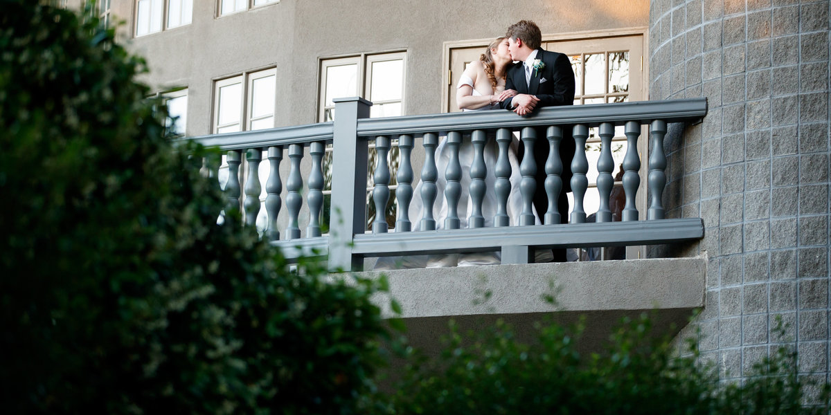 Austin wedding photographer castle avalon wedding photographer bride groom back balcony