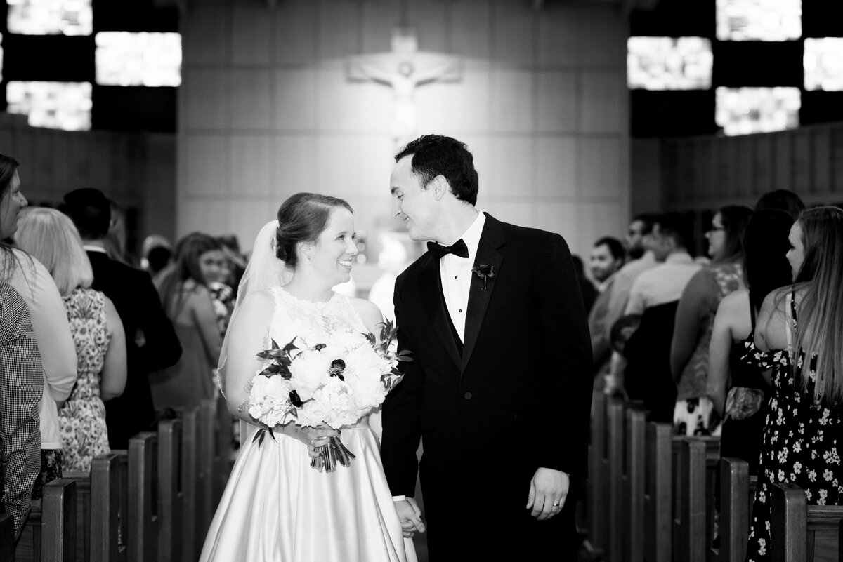 bride and groom looking at each other during recessional for their wedding