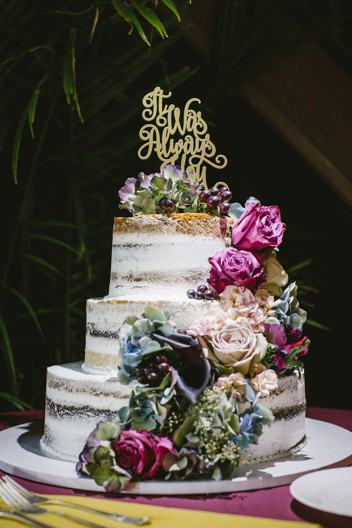naked wedding cake with flowers at water witch club