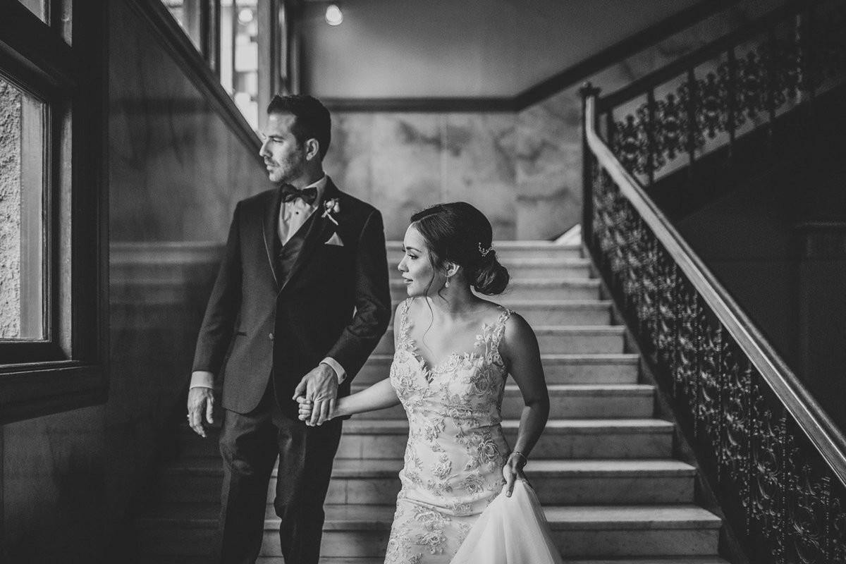 Bride & groom walk down the stairs before their Castle Green wedding in Pasadena, Ca.