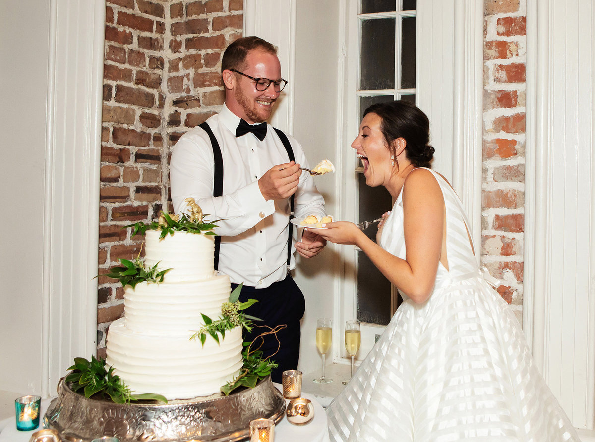 felicity-church-groom-feeding-bride-cake
