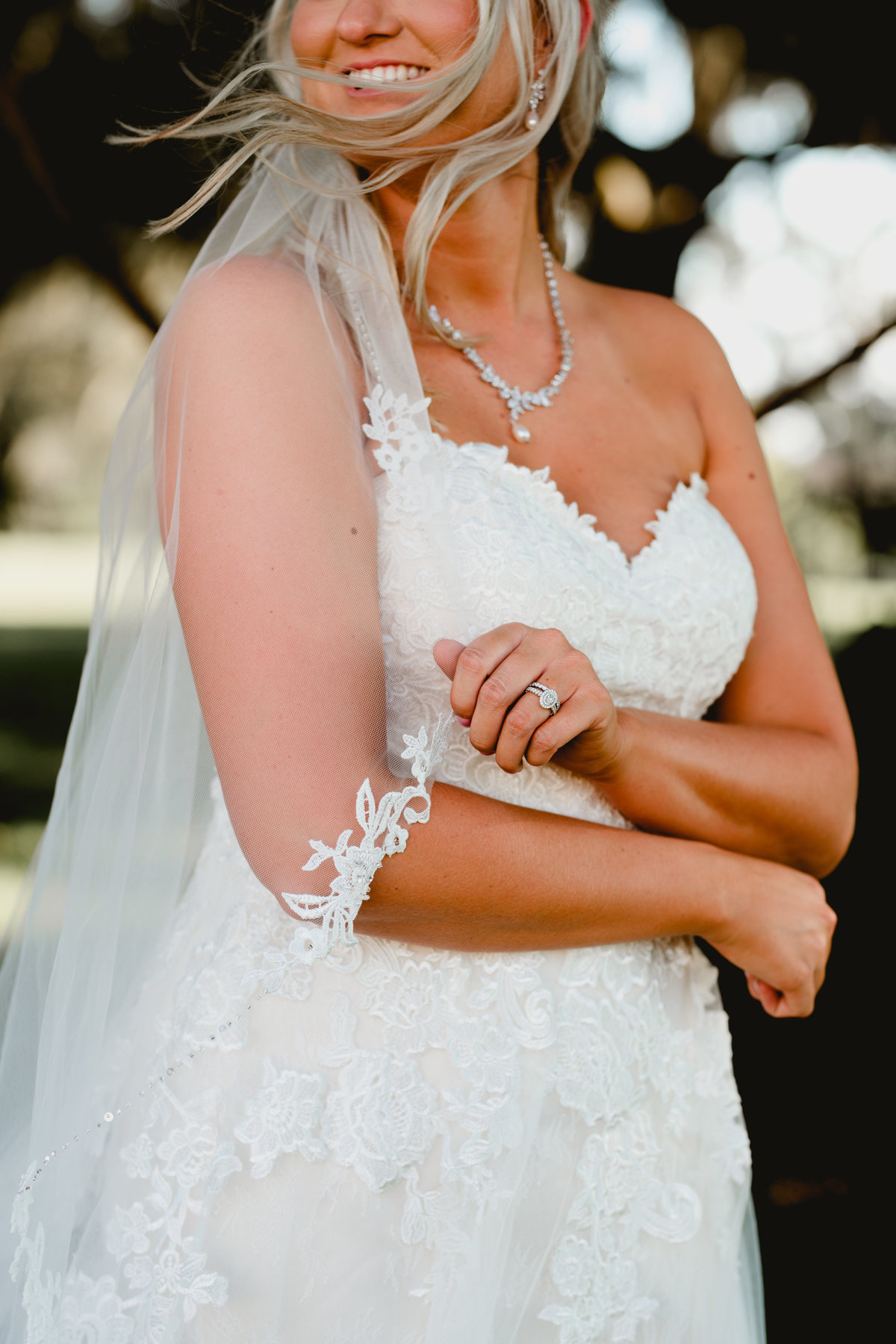 Beautiful bride takes bridal portraits with professional photographer in Florida.