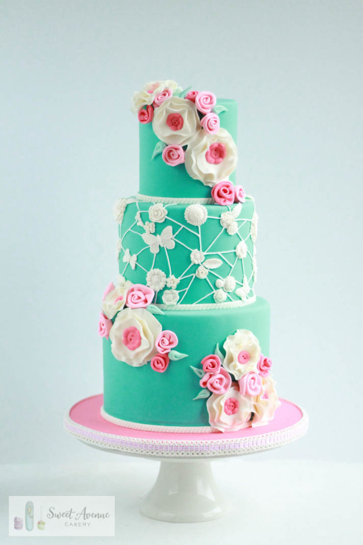 pink and teal cake with flowers